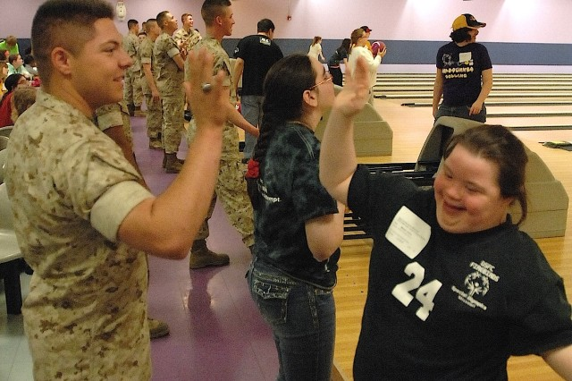 Dana Marler, from the Franklin County School District in New Haven, Missouri, gets a high-five from Marine Pfc. Alex Hill during the 2016 Special Olympics of Missouri State Indoor Games. Fort Leonard Wood is set to host the games again in 2017.