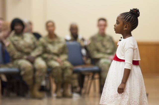 "Laryssa Watkins, 5, recites the poem, ""Hey, Black Child,"" by Countee Cullen during the National African American History Month Observance in Heritage Hall at Rock Island Arsenal, Illinois, Feb. 14."