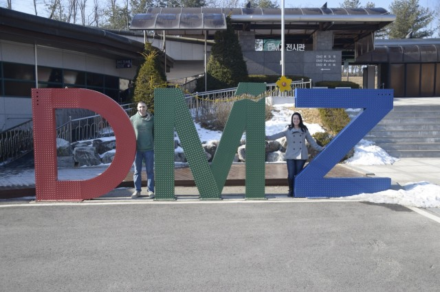 Pfc. Nicholas Babel and Pfc. Emma Frerichs, both 35th ADA Brigade, stand in the middle of a DMZ sign during a staff ride to the Demilitarized Zone, Republic of Korea, Feb. 14, 2017. The purpose of the staff ride was to provide Soldiers with a better understanding of Korea's history.
