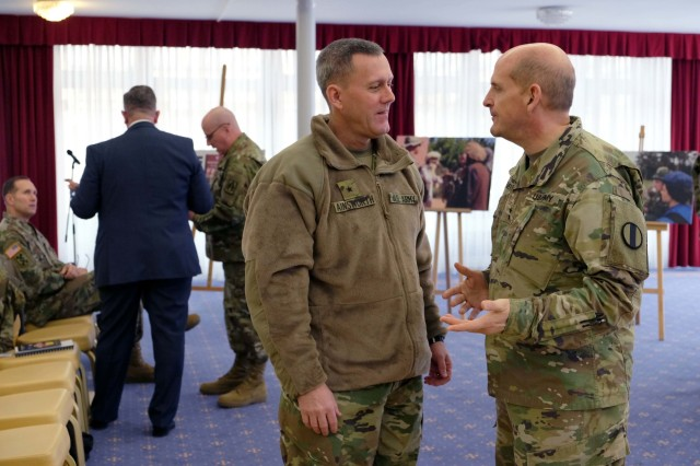 Brig. Gen. Steven W. Ainsworth, commanding general of the 7th Mission Support Command, left, speaks to Maj. Gen. Paul Benenati, right, one of the unit's former commanding generals, during the 7th MSC Panel Forum Feb. 10 at the Armstrong Club. This year, the U.S. Army Reserve in Europe celebrates more than 60 years of operations by looking at the past, present and future. Discussion topics included USAR participation in past operations from post-WWII era all the way up to the ongoing operation Atlantic Resolve in the Baltic States.