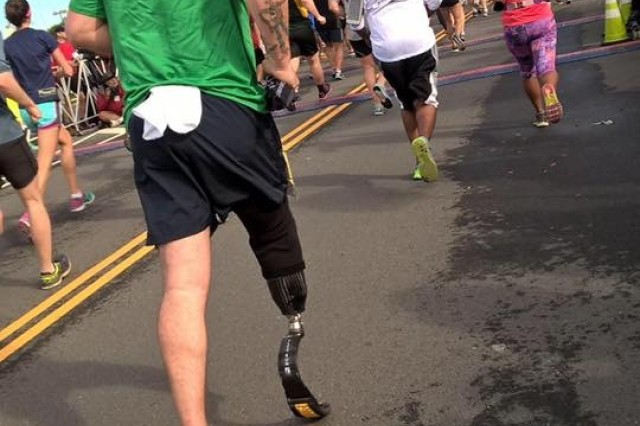 Sgt. 1st Class Kenneth Keith completing the Army 10 Miler in Washington, D.C. 11 months after amputation. 'It's a disability ,but I'm not disabled.' said Keith. 'My goal is to do whatever I can do to stay active duty.'