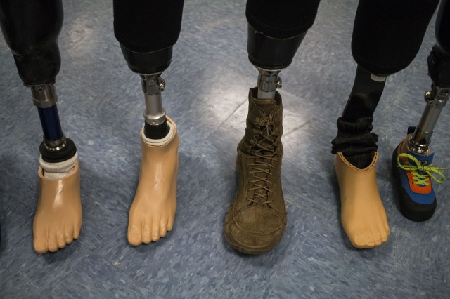 "'The cute little baby one helps me with climbing,"" said Staff Sgt. Christopher Hudec, identifying the prosthetic at the far right. Hudec has eight prosthetic legs that each do different jobs."