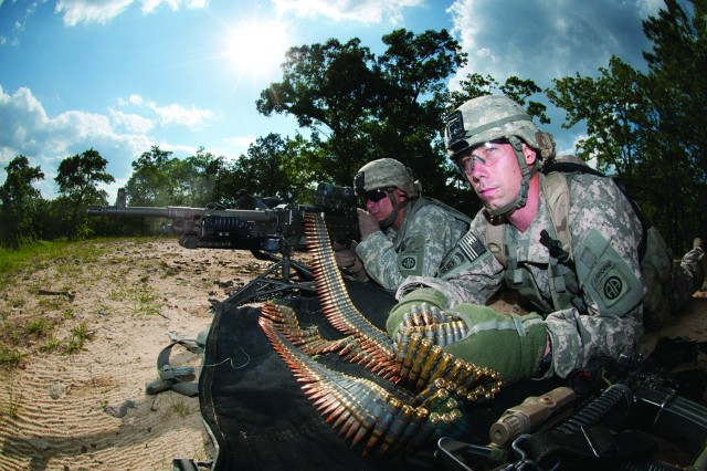 Spc. Robert Woodworth feeds ammunition to Spc. John Thrasher's M240-B machine gun as the two help to provide covering fire for their platoon during the assault on an enemy position that was part of a war-game exercise May 4, 2011, at Fort Bragg, N.C. Those who use ammunition will benefit from an improved automated ammunition system that is more secure, transparent and user-friendly.