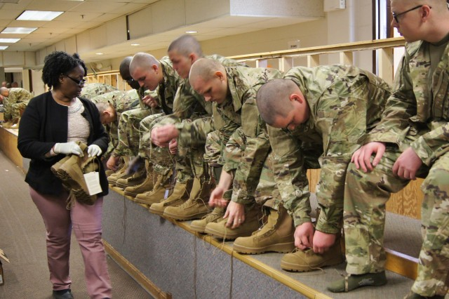 Flora Shelton, left, a Logistics and Readiness Center boot and shoe fitter, 43rd Adjutant General Battalion, ensures the proper fit of Soldier's boots when they receive their initial issue of uniforms at the beginning of Basic Combat Training at Fort Leonard Wood.