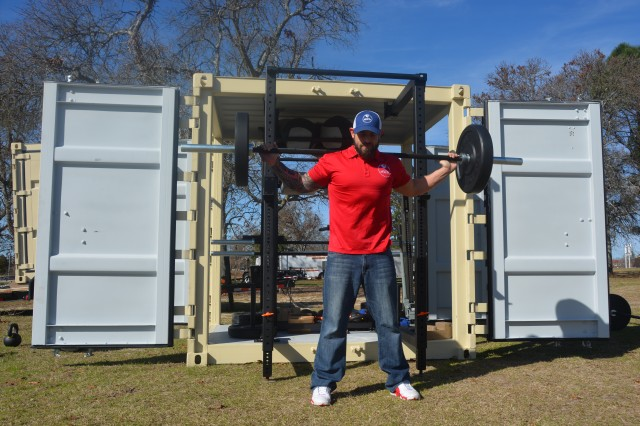 FORT GORDON, Ga. (Feb. 6, 2017) -- Josh Woody, Gordon Fitness Center assistant manager and fitness coordinator, shows off the equipment available for use with new Mobile Fitness Unit.