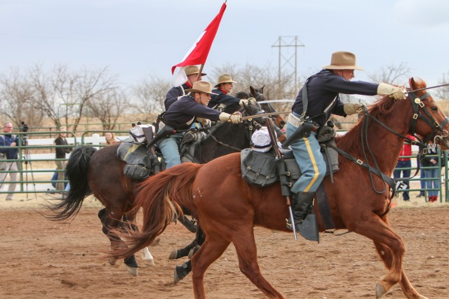B Troop, 4th U.S. Cavalry Regiment (Memorial) demonstrate a cavalry charge for visiting exchange students from Radebeul, Germany, Feb. 14 at Buffalo Corral.  (Photo Credit: Fort Huachuca Public Affairs Lara Poirrier)