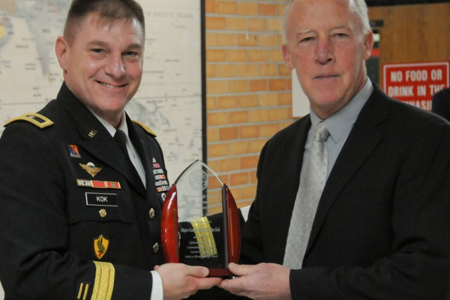 Maj. Gen. Troy D. Kok, commanding general of the U.S. Army Reserve's 99th Regional Support Command, left, is inducted into the Allentown High School Hall of Fame Feb. 17 during a ceremony at the school. Kok was nominated for the school's hall of fame by his former football and cross-country coach, Doug Hunt, right, who taught at Allentown High School for 39 years.