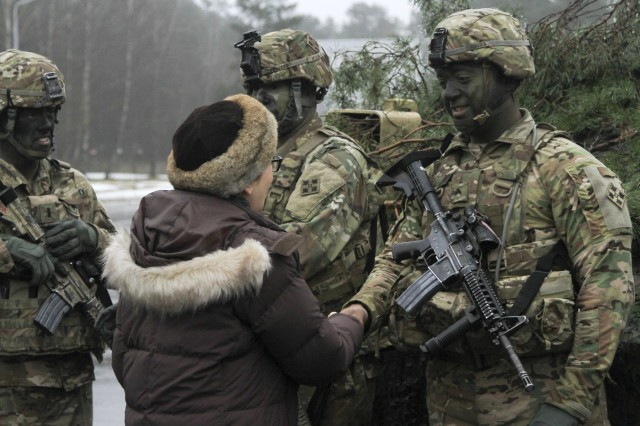 CAMP ADAZI, Latvia - U.S. Ambassador Nancy Bikoff Pettit shakes hands with Cpl. Nicholas Hodges, infantryman, 1st Battalion, 68th Armor Regiment, 3rd Armored Brigade, 4th Infantry Division, following a welcome ceremony hosted by the Latvian Land Forces at Camp Adazi, Latvia, Feb. 17, 2017. The arrival of 1-68 AR, in support of Operation Atlantic Resolve, marks the beginning of continuous U.S. armored brigade presence in Europe. Operation Atlantic Resolve is a U.S. led effort in Eastern Europe that demonstrates U.S. commitment to the collective security of NATO and dedication to enduring peace and stability in the region. (U.S. Army photo by Sgt. Lauren Harrah/Released)