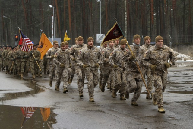 CAMP ADAZI, Latvia - Latvian soldiers assigned to the Latvian Land Forces Infantry Brigade and U.S. Army Soldiers assigned to 1st Battalion, 68th Armor Regiment, 3rd Armored Brigade, 4th Infantry Division, complete an esprit de corps run, Feb. 17, 2017 at Camp Adazi, Latvia. The run brought U.S. and Latvian soldiers together following a welcome ceremony honoring the arrival of 1-68 AR in support of Operation Atlantic Resolve. Atlantic Resolve is a U.S. led effort in Eastern Europe that demonstrates U.S. commitment to the collective security of NATO and dedication to the enduring peace and stability in the region. (U.S. Army photo by Sgt. Lauren Harrah/Released)