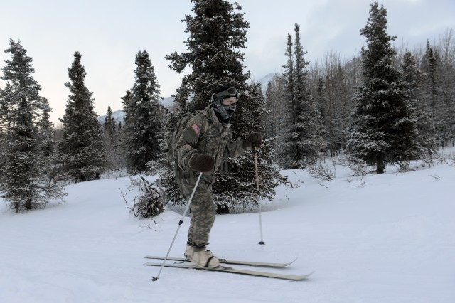 A student cross country skis on White Rocket skis. The boots are called Vapor Barrier and keep feet warm and dry.