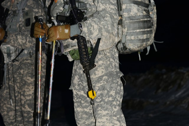 Soldiers begin the biathlon early in the morning while it's still dark.