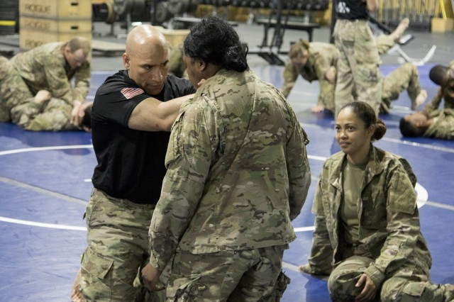 U.S. Army Master Sgt. Luis E. Barsallo, of the 369th Sustainment Brigade, demonstrates a choke technique during a combatives course at Camp Arifjan, Kuwait, on January 28, 2017. The Combatives Level One course is designed not only to provide instruction in hand-to-hand combat techniques, but also produce platoon level trainers, who can teach the basic tasks and drills to their fellow Soldiers. (U.S. Army photo by Sgt. Cesar E. Leon)