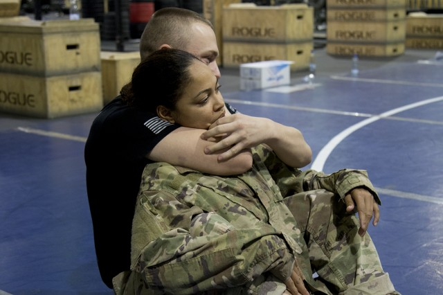 U.S. Army Spc. Orquidea Rosa, of the 369th Sustainment Brigade, helps demonstrate a choke technique during a combatives course at Camp Arifjan, Kuwait, on January 28, 2017. The Combatives Level One course is designed not only to provide instruction in hand-to-hand combat techniques, but also produce platoon level trainers, who can teach the basic tasks and drills to their fellow Soldiers. (U.S. Army photo by Sgt. Cesar E. Leon)