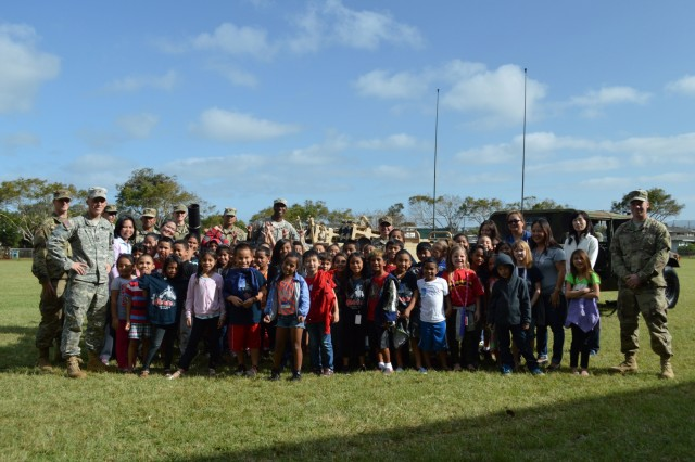 Soldiers assigned to 3rd Squadron, 4th Cavalry Regiment, 3rd Brigade Combat Team, 25th Infantry Division, and students from Ka'ala Elementary School stand together during the school's career day event at Wahiawa, Hawaii, on Feb. 1, 2017. More than a dozen soldiers from 3-4th Cav. Regt. participated in the annual event. (U.S. Army photo by Staff Sgt. Armando R. Limon, 3rd Brigade Combat Team, 25th Infantry Division)