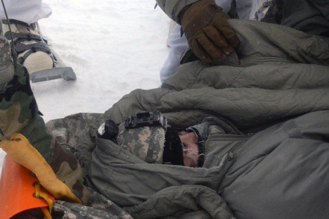 "An avalanche ""victim"" is wrapped up and placed on the rescue sled during the bivouac portion of the Cold Weather Leaders Course, Feb. 9-14, 2017.  The CWLC is taught at the Northern Warfare Training Center at Black Rapids, Alaska.  The entire course ran Feb. 2-16, 2017."