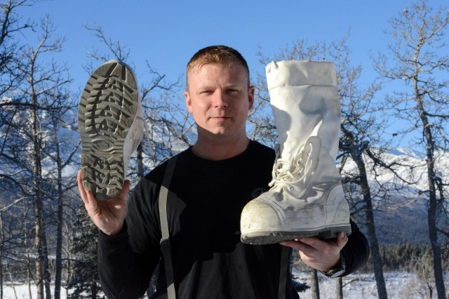 Sgt. Eric Martin, a medic, shows what Canadian army-issued Mutluks look like.