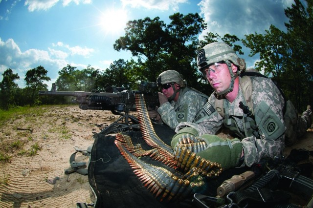Army Spc. Robert Woodworth feeds ammunition to Army Spc. John Thrasher's M240B machine gun as the two help to provide covering fire for their platoon during the assault on an enemy position that was part of a war-game exercise held at Fort Bragg, N.C., May 4, 2011. The Army's ammunition community will benefit from a new, improved automated information system that is more secure, transparent and user-friendly.