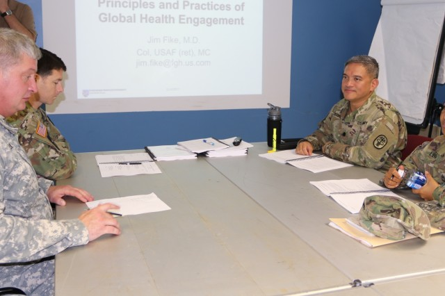 Regional Health Command-Pacific (RHC-P) active duty and civilian personnel participated in the Fundamentals of Global Health Engagement (FOGHE) course held on Ft. Shafter Flats, Hawaii. Lt. Col. Robert Vasquez (top right), command judge advocate, RHC-P, works with other participants during a small group exercise on strategic guidance and rationale on the first day of the FOGHE course.