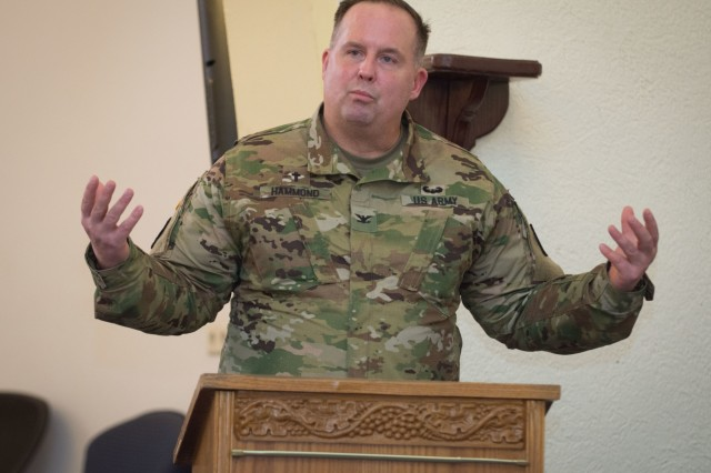 """LANDSTUHL, Germany - Chaplain (Col.) Scott Hammond, command chaplain, 21st Theater Sustainment Command, addresses the audience prior to the unveiling of a painting made by the children of the 212th Combat Support Hospital through the """"Worship Thru Art"""" grant, February 15, 2017.  (U.S. Army Photo by Capt. Jerome C. Ferrin, 30th Medical Brigade Public Affairs)"""