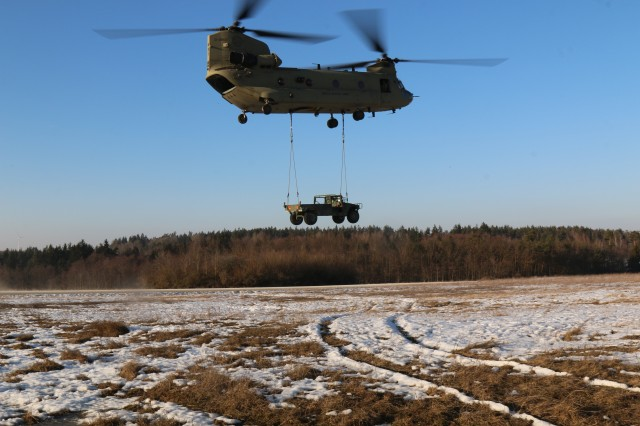 A CH-47, Chinook, transports a HMMWV during the Pathfinder Course, Feb. 14, 2017, in the Grafenwoehr Training Area. The Pathfinder Course prepares Soldiers to establish day and night landing zones for cargo drops, and provide air traffic control and navigational assistance to rotary and fixed wing aircrafts.