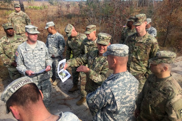 Sgt. 1st Class Christopher Parker briefs Lt. Col. Paul Grant on his firing positions based on surface danger zone constraints on the range at Fort Stewart, Georgia, on Dec. 1, 2016. Surface danger zones and weapons danger zones are critical to setting up a successful range.
