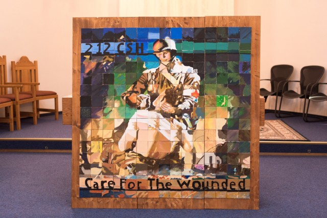 """KAISERSLAUTERN, Germany -- """"Caring for the Wounded,"""" a painting made by the children of the 212th Combat Support Hospital after being unveiled by the 212th Combat Support Hospital Unit Ministry Team, February 15, 2017. (U.S. Army Photo by Maj. Chris N. Angeles, 212th Combat Support Hospital Public Affairs)"""