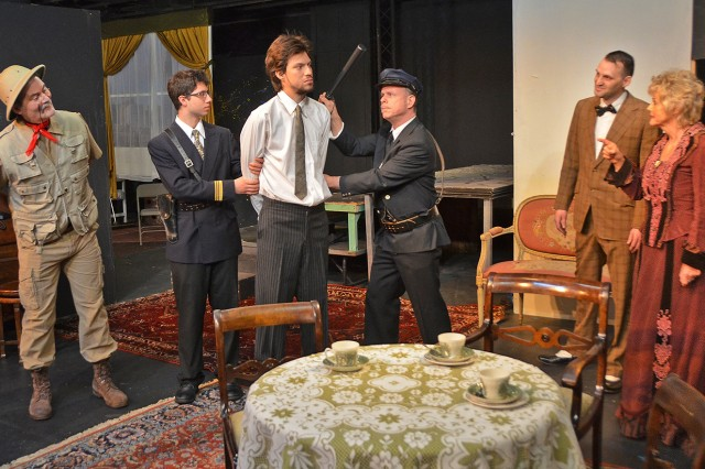 "The cast of ""Arsenic and Old Lace"" rehearse a scene for the Amelia Earhart Playhouse's upcoming production."