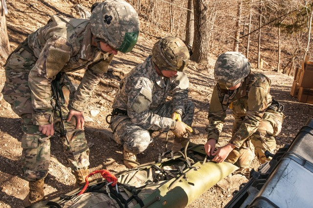Soldiers in Sapper Leader Course 06-17 prepare a simulated casualty for extraction down a 90-foot cliff during mountaineering operations Feb. 17.