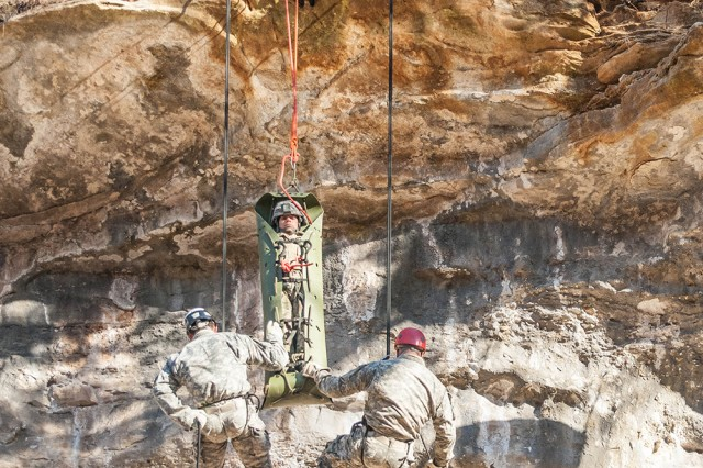 Soldiers in Sapper Leader Course 06-17 demonstrate to instructors a vertical evacuation of a casualty Feb. 17 during the mountaineering operations portion of Sapper Leader Course.