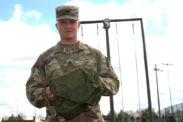 Sgt. Chase Rapp, a human resource noncommissioned officer with 716th Military Police Battalion, 101st Airborne Division (Air Assault) Sustainment Brigade, 101st Abn. Div., poses with his personal medical aid bag -- the one he used to help save the life of a man involved in a car crash near Floyd Knobs, Indiana, Jan. 28, 2017.