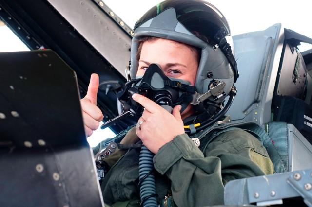 Sgt. Ashlee Saalfeld, 1-11th Avn. Regt., gives a thumbs up while in the back of an F-16 Fighting Falcon Feb. 15 at Maxwell AFB.
