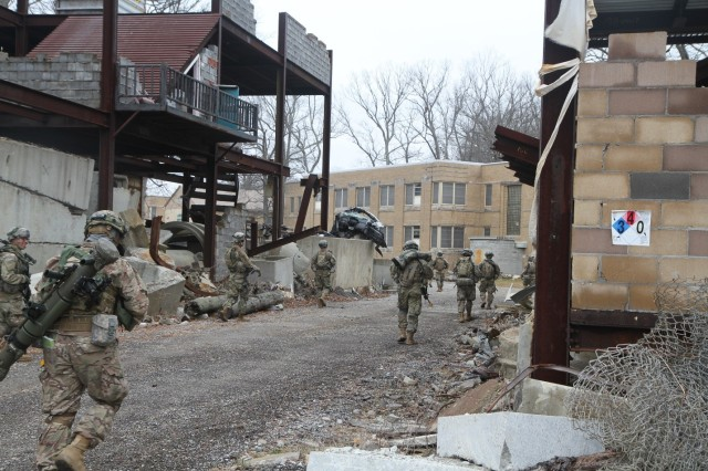 Soldiers with Company B, 1st Battalion, 327th Infantry Regiment, 1st Brigade Combat Team, 101st Airborne Division escort role players simulating nongovernmental personnel on a humanitarian aid mission at Muscatatuck Urban Training Center, Butlerville, Indiana, Feb. 8, 2017. The unit traveled to MUTC for a 72-hour validation exercise in preparation for their upcoming East African Response Force mission. (U.S. Army photo by 2nd Lt. Nathaniel BeLiles, 1-327th, 1st Brigade Combat Team Unit Public Affairs Representative)