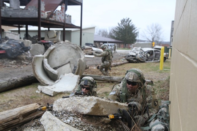 Spc. Anthony Archer and Spc. Jermey Parker of Company B, 1st Battalion, 327th Infantry Regiment, 1st Brigade Combat Team, 101st Airborne Division provide security after an ambush from hostile forces at Muscatatuck Urban Training Center, Butlerville, Indiana, Feb. 8, 2017. The unit deployed to MUTC for a 72-hour validation exercise in preparation for their upcoming East African Response Force mission. (U.S. Army photo by 2nd Lt. Nathaniel BeLiles, 1-327th, 1st Brigade Combat Team Unit Public Affairs Representative)