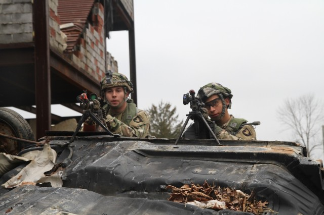 Soldiers from Company B, 1st Battalion, 327th Infantry Regiment, 1st Brigade Combat Team, 101st Airborne Division provide security after an ambush from hostile forces at Muscatatuck Urban Training Center, Butlerville, Indiana, Feb. 8, 2017. The unit deployed to MUTC for a 72-hour validation exercise in preparation for their upcoming East African Response Force mission. (U.S. Army photo by 2nd Lt. Nathaniel BeLiles, 1-327th, 1st Brigade Combat Team Unit Public Affairs Representative)