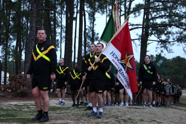 "Lt. Col. Marcus Welch, commander of 8th Military Information Support Battalion, 4th Military Information Support Group, returns from a four-mile run with his Paratroopers on Feb. 3, 2017, honoring Staff Sgt. Mark Stets, Jr., who was killed in action Feb. 3, 2010. Unit leaders and Stets' parents took time before and after the run to speak of their memories of the fallen Soldier. The formation ran with Stets' ""Honor and Remember"" flag in front of the battalion colors."