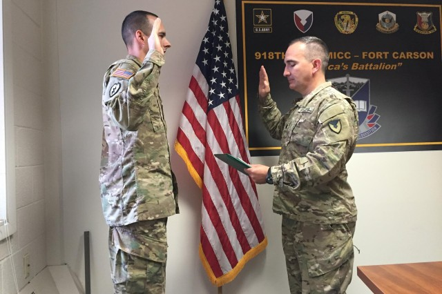Sgt. 1st Class Matthew Girard re-enlists during a ceremony Sept. 20 at Fort Carson, Colorado. Lt. Col. Thomas McFall administers the oath of enlistment to Girard at the 918th Contracting Battalion at Fort. The secretary of the Army named Girard the Contracting Noncommissioned Officer of the Year as part of the Secretary's Fiscal 2016 Awards for Excellence in Contracting. Girard was a contract specialist with the 918th CBN and is now stationed in Italy. McFall is the 918th CBN and MICC-Fort Carson commander.