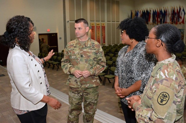 Brenda Clark (left), AMEDDC&S Sexual Assault Response Coordinator (SARC), discusses the Army SHARP program with CSM Aaron Stone, 187th MED BN Command Sergeant Major, Nykita Riley, SARC, 32d MED BDE, and MAJ Felicia Williams, HSC, AMEDDC&S Victim Advocate.