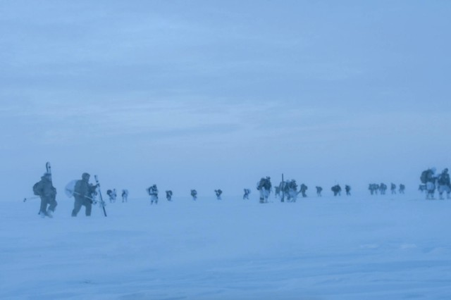 Paratroopers move out on skis and snowshoes after jumping into Deadhorse, Alaska, in minus 56 degrees Fahrenheit wind chill temperatures to find a crashed satellite during Spartan Pegasus exercise, Feb. 22, 2017.  Participating were 150 Soldiers from Alaska-based 25th Infantry Division's 4th Infantry Brigade Combat Team (Airborne).