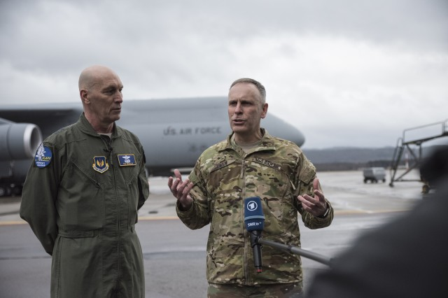 Maj. Gen. Timothy Zadalis, the U.S. Air Forces in Europe and Air Forces Africa vice commander, and Brig. Gen. Phillip Jolly, the U.S. Army Europe deputy commanding general for Mobilization and Reserve Affairs, speaks to the media, Feb. 22, on Ramstein Air Base, Germany. Two large U.S. Air Force C-5M Galaxies transported four AH-64 Apache helicopters from Fort Bliss, Texas in support of Operation Atlantic Resolve.