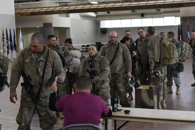Soldiers assigned to the 207th Engineer Company, Kentucky Army National Guard and the 215th Engineer Company, U.S. Army Reserve are weighed, manifested and processed prior to boarding an aircraft at the Silas L. Copeland Arrival/Departure Airfield Control Group here Feb. 2, 2017 for a deployment in support of Operation Freedom's Sentinel.