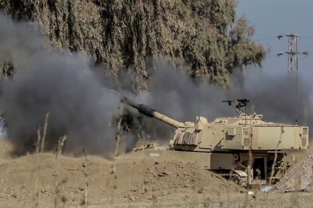 Soldiers fire an M109A6 Paladin from a tactical assembly area at Hamam al-Alil, in support of the start of the Iraqi security forces' offensive in West Mosul, Iraq, Feb. 19, 2017. They are assigned to 2nd Battalion, 82nd Field Artillery Regiment, 3rd Armored Brigade Combat Team, 1st Cavalry Division. More than 60 Coalition partners have committed themselves to the goal of eliminating the threat posed by ISIS and have contributed in various capacities to the effort. CJTF-OIR is the global Coalition to defeat ISIS.