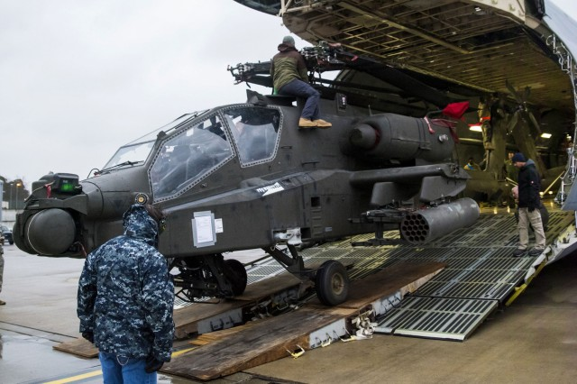 Four Apache helicopters were transported and downloaded from two C-5M Galaxy airplanes at Ramstein Air Base, Germany, Feb. 22. The Apache helicopters came to Europe in support of Operation Atlantic Resolve as part of the United States' commitment to the security of Europe.