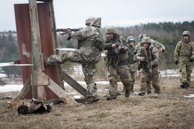 A Ukrainian combat training center engineer kicks in a door after using a breaching charge while & Breaching barriers in Ukraine | Article | The United States Army