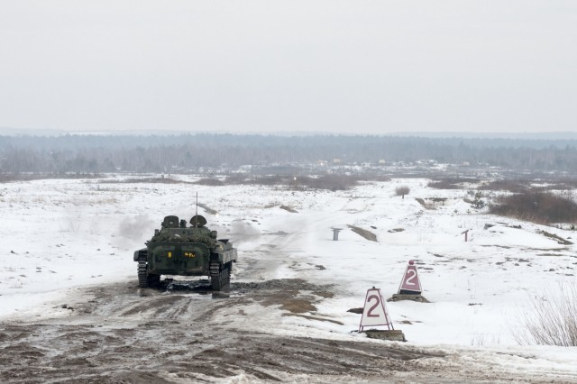 A Ukrainian army BMP-2 armored vehicle engages targets during gunnery training at the International Peacekeeping and Security Center, near Yavoriv, Ukraine, on Feb. 17.
