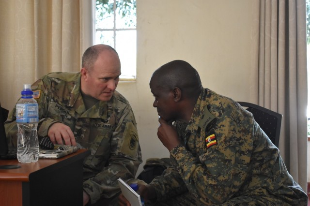 Sgt. Maj. Scott Peirsol, USARAF G7 Trex and Ugandan Lt. Col. Michael Katambira discuss training during the Africa Readiness Training 2017 initial planning event in Jinja, Uganda, Feb. 16, 2017. Africa Readiness Training 2017 is a bilateral exercise between Ugandan and U.S. forces scheduled to take place in July in Uganda. (U.S. Army Africa photo)