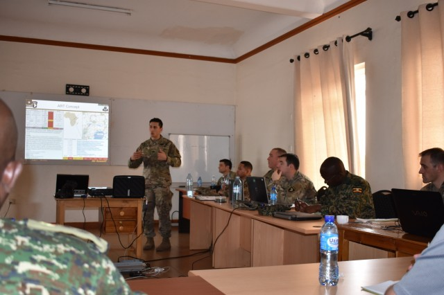 Capt. Nick Little, the assistant S3 for 1-327 Infantry Battalion, briefs the operational plan to exercise planners during the African Readiness Training 2017 initial planning event in Jinja, Uganda, Feb. 14, 2017. Africa Readiness Training 2017 is a bilateral exercise between Ugandan and U.S. forces scheduled to take place in July in Uganda. (U.S. Army Africa photo)