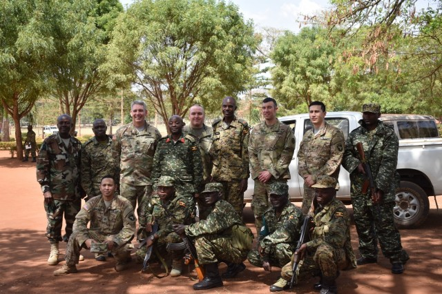 U.S. and Ugandan soldiers pause for a photo in Singo, Uganda, during the initial planning event for the African Readiness Training 2017 exercise Feb. 15, 2017. Africa Readiness Training 2017 is a bilateral exercise between Ugandan and U.S. forces scheduled to take place in July in Uganda. (U.S. Army Africa photo)
