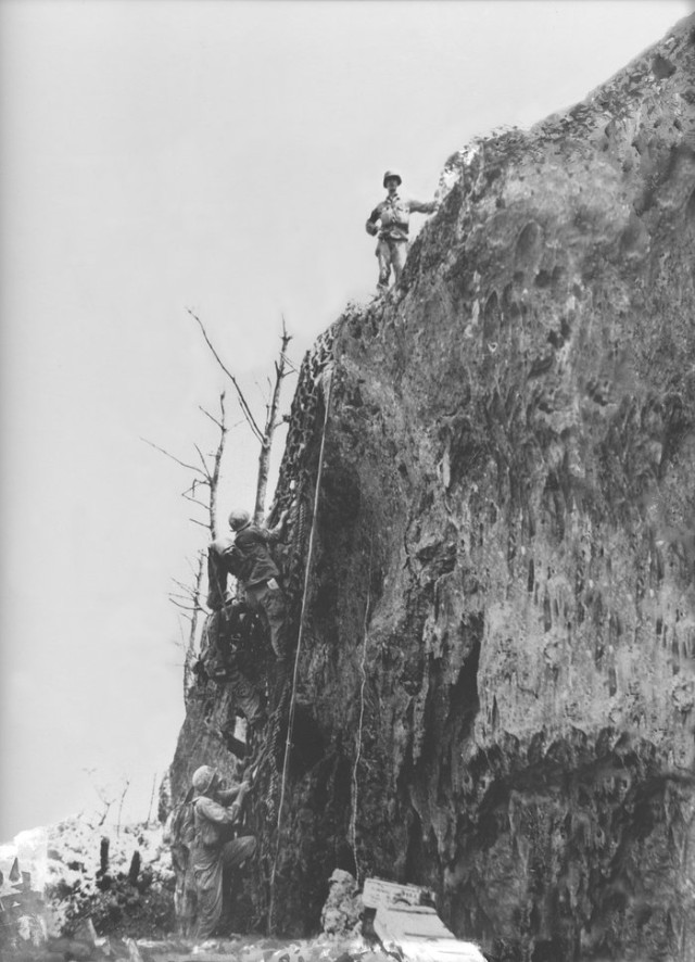 Doss, seen here at the top of Hacksaw Ridge