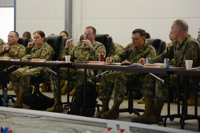 Lt. Gen. Ben Hodges (C), U.S. Army Europe Commander gives feedback to Col. PatricK Ellis (to the right), commander for 2nd Cavalry Regiment, with Lt. Col. Steven Gventer (far right), commander for 2nd Squadron, 2CR during the Rehearsal of Concept Drill on the 2nd Squadron mission plan for NATO's enhanced Forward Presence in Poland Feb. 24, 2017 on Rose Barracks, Vilseck, Germany. The Squadron will convoy through Germany, Czech Republic and Poland to reach their destination in Orzysz where they will remain for six months as a part of the overall deterrence and defense posture in the area.