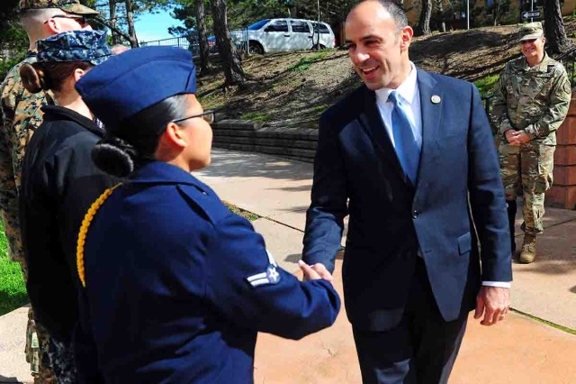 PRESIDIO OF MONTEREY, California - Airman 1st Class Alexis Fernandez, 314th Training Squadron (left) meets Congressman Jimmy Panetta here at Belas Hall Dining Facility during Feb. 22.